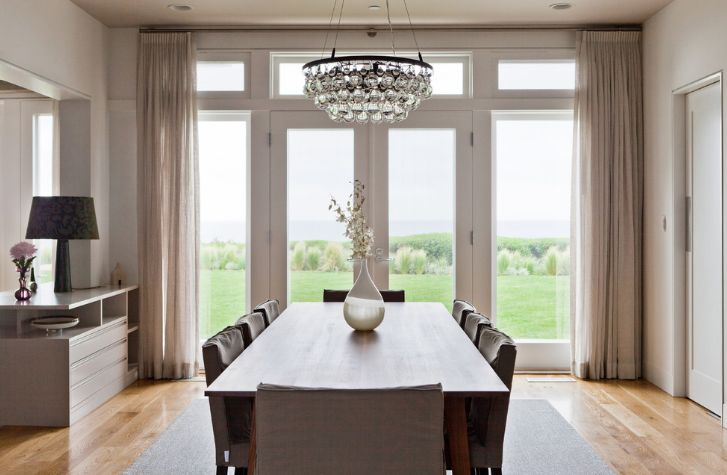Glass chandelier above the dining table