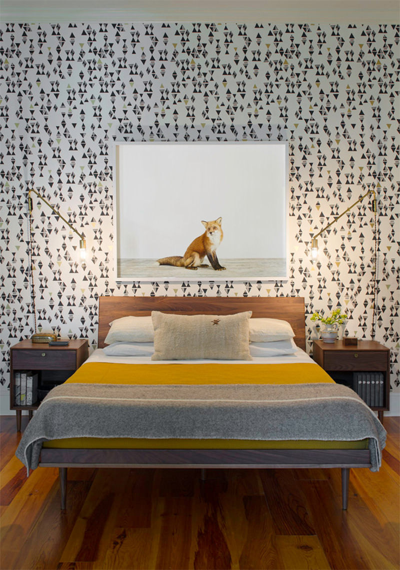 Yellow bedding and cool wallpaper