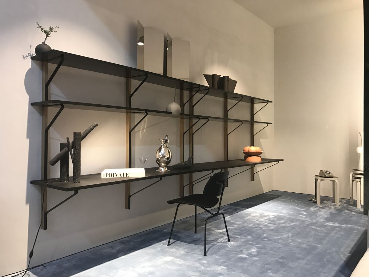 A shelving unit can have a built-in desk at the bottom, a cool combination for offices or multipurpose rooms