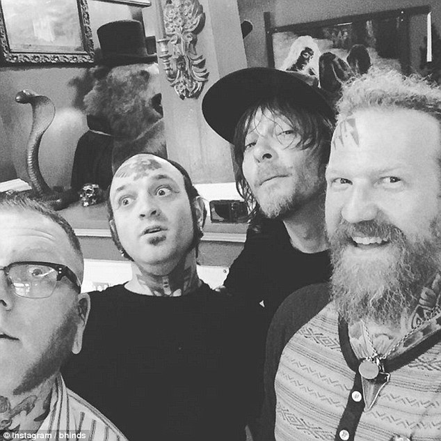 Tattoo tribute: Norman Reedus (second from right) and Mastodon guitarist Brent Hinds (right) got matching Lemmy tattoos at the Abracadabra Tattoo shop in New Orleans over the weekend