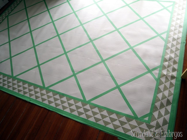 Tape a pattern to paint a remnant of linoleum to look like an area rug for under your dining room table! {Sawdust and Embryos}