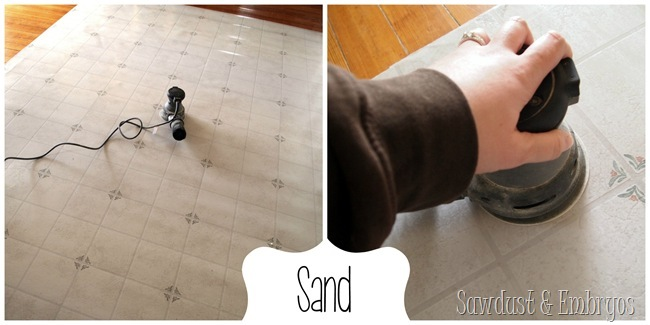 Sand and PAINT a remnant of linoleum for a dining room area rug.