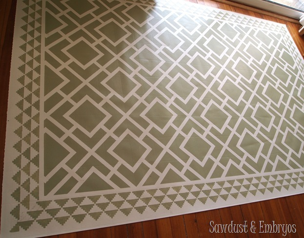 This is a remnant of linoleum that was PAINTED to look like an area rug for under the dining room table! SUPER durable and wipeable!