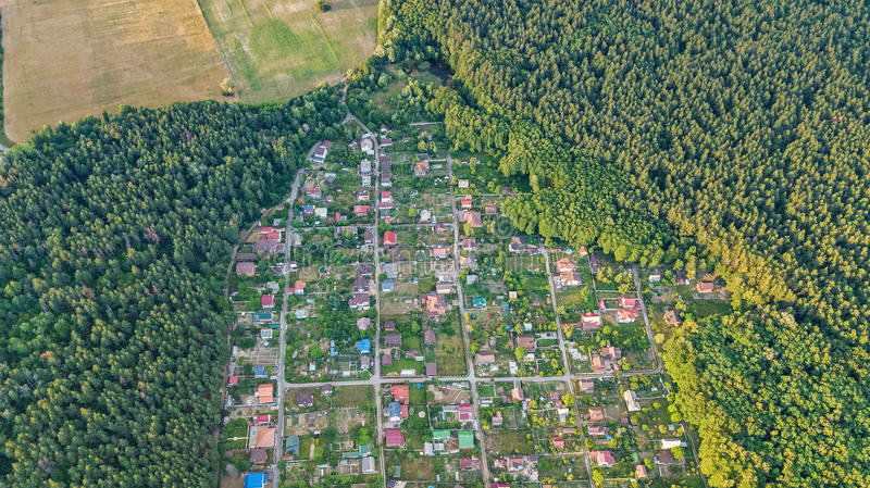 Aerial top view of residential area summer houses in forest from above, countryside real estate and dacha village in Ukraine. Aerial top view of residential area stock photography