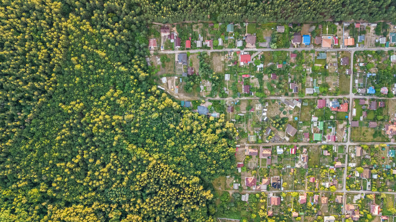 Aerial top view of residential area summer houses in forest from above, countryside real estate and dacha village in Ukraine. Aerial top view of residential area royalty free stock photos