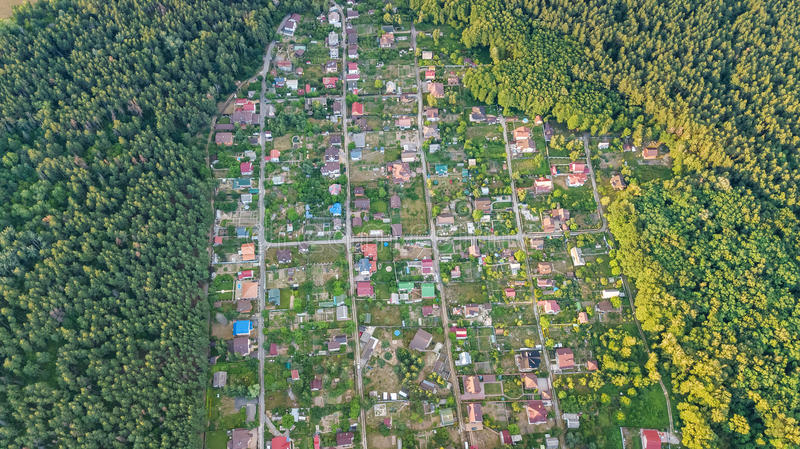 Aerial top view of residential area summer houses in forest from above, countryside real estate and dacha village in Ukraine. Aerial top view of residential area royalty free stock images