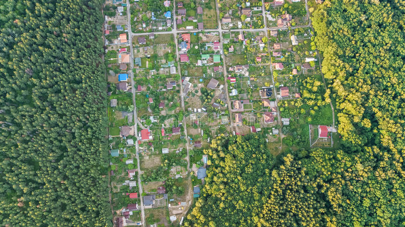 Aerial top view of residential area summer houses in forest from above, countryside real estate and dacha village in Ukraine. Aerial top view of residential area royalty free stock photo