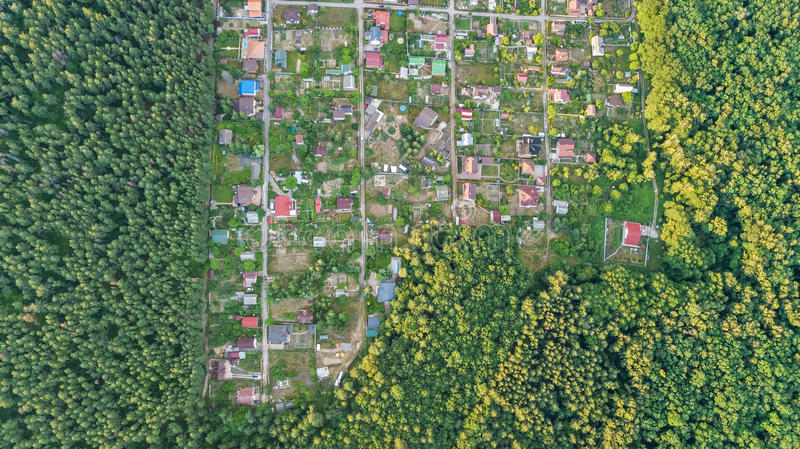 Aerial top view of residential area summer houses in forest from above, countryside real estate and dacha village in Ukraine. Aerial top view of residential area stock photos