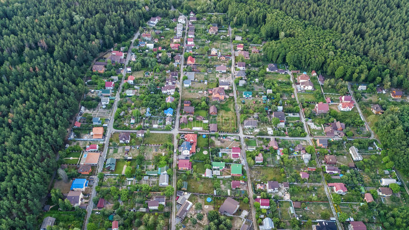 Aerial top view of residential area summer houses in forest from above, countryside real estate and dacha village in Ukraine. Aerial top view of residential area stock image