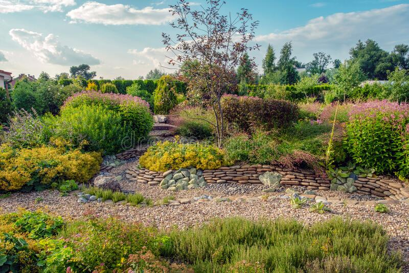 Amazing `dry stream`  - garden feature - near dacha in `Belgian village` in moscow oblas. T- awe nature in summer in russia stock photo