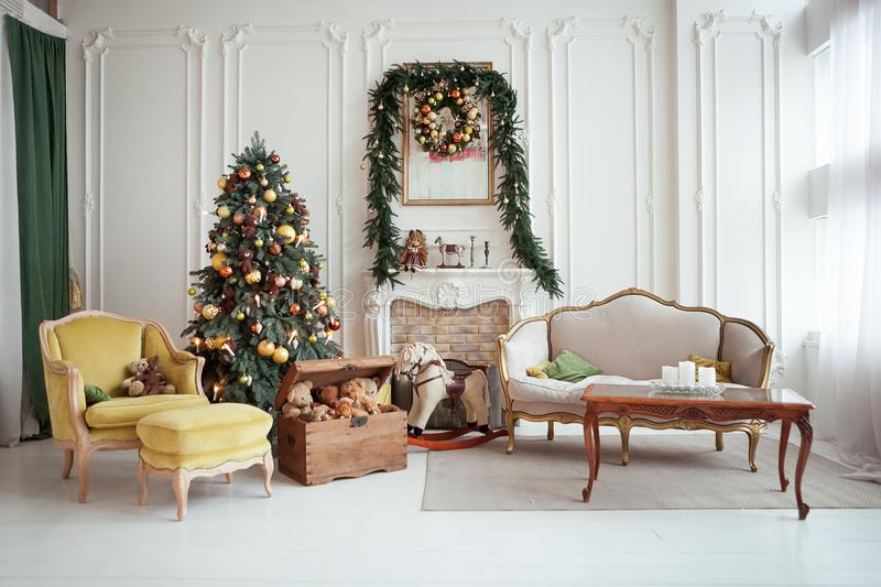 Beautiful Christmas interior. New year decoration. Living room with fireplace. Beautiful Christmas interior. Isolated wreath on wall. New year decoration. Living royalty free stock photos