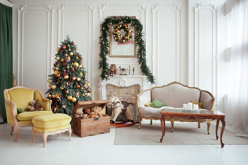 Beautiful Christmas interior. New year decoration. Living room with fireplace.  royalty free stock photos
