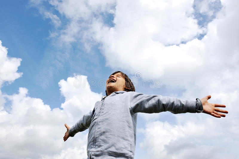 Child, freedom, breathing fresh air. In nature royalty free stock photos