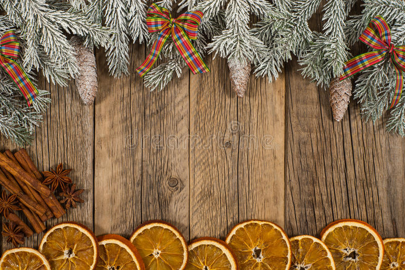 Christmas composition.Branch ate with oranges, pine cones and ri royalty free stock images