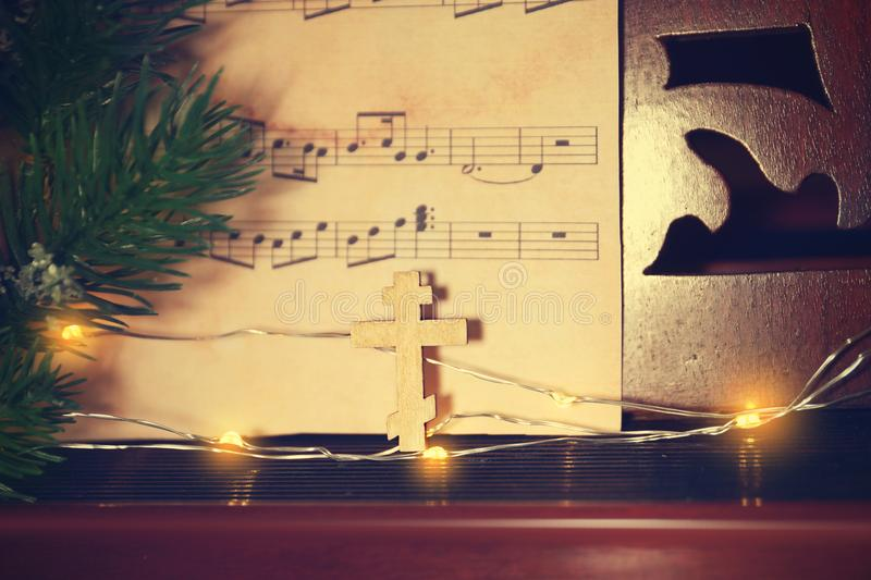 Christmas composition with wooden cross royalty free stock image
