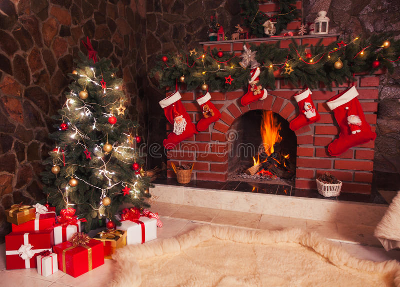 Christmas fireplace in the room. Christmas decorated fireplace and tree in the room royalty free stock photography