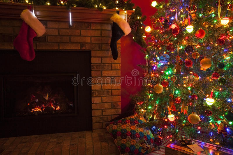 Christmas Fireplace. With stockings and Christmas tree and gifts royalty free stock photo
