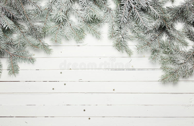 Christmas and New Year decoration composition. Top view of fur-tree branches on wooden background with place for your royalty free stock photo