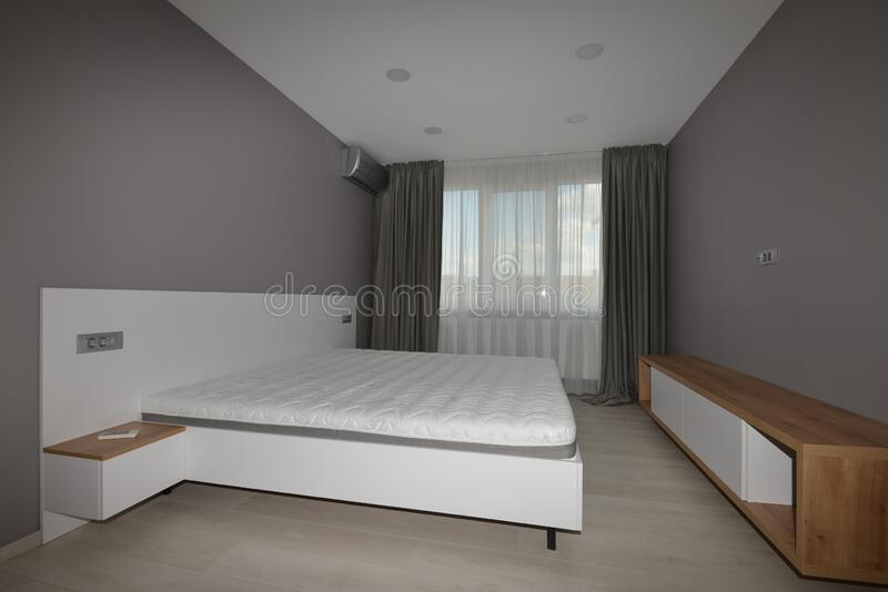Bedroom with compact large bed. stock images