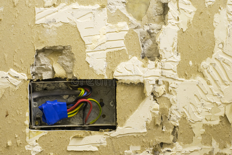 DIY electrical socket and plasterwork royalty free stock photography