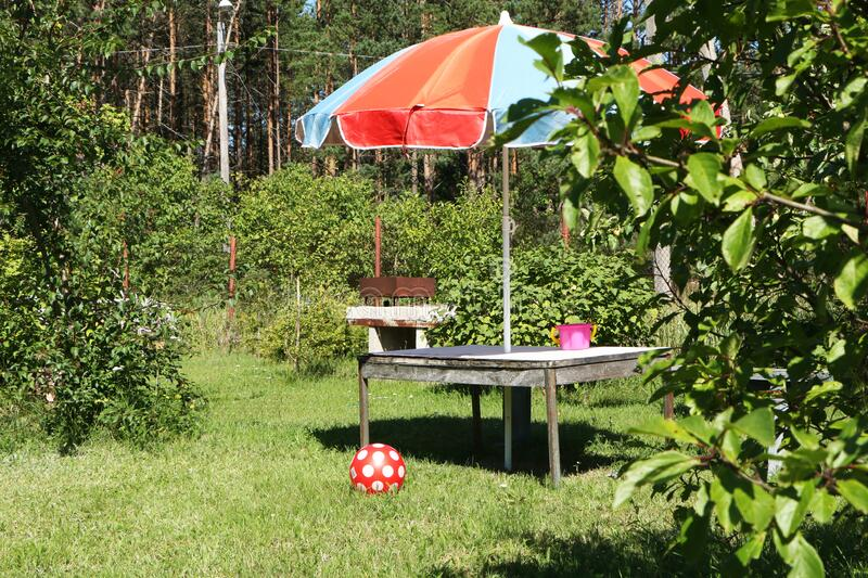 Vacation in the summer at the dacha with children. Family vacation in the summer at the dacha with children stock image