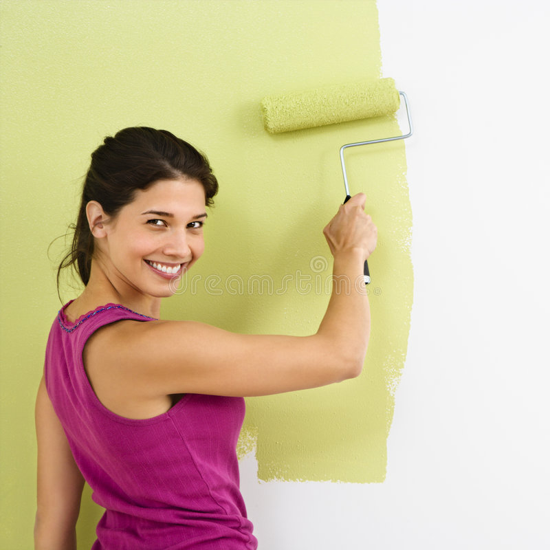Happy woman painting. stock photography