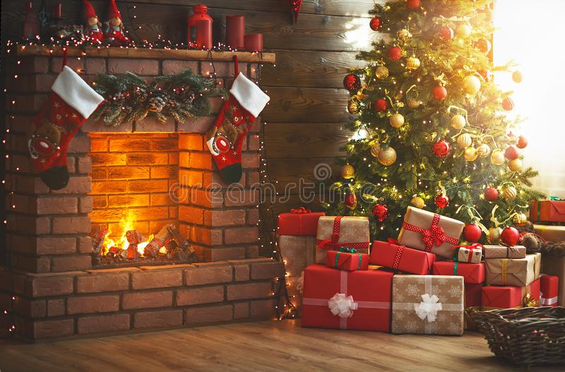 Interior christmas. magic glowing tree, fireplace, gifts. Interior christmas. magic glowing tree, fireplace and gifts royalty free stock images