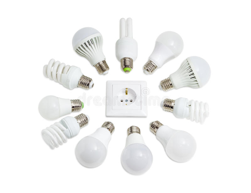 LED lamps and compact fluorescent lamps around socket outlet. Several different domestic light emitting diode lamps and compact fluorescent lamps with a sized royalty free stock photography