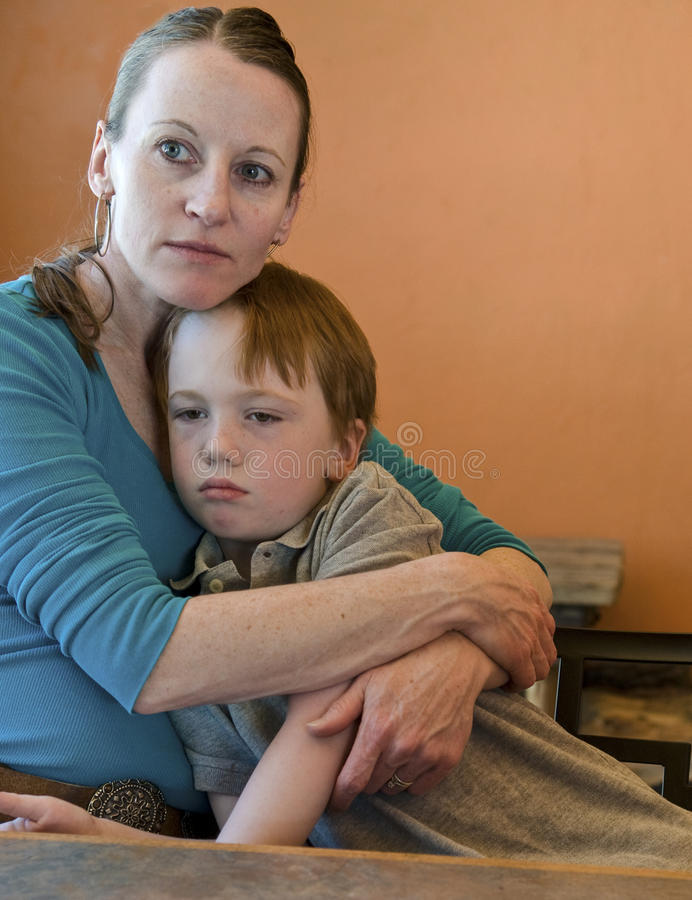 Mom hugging sad child. Mother hugs her crying/sad 6-year old son royalty free stock photos