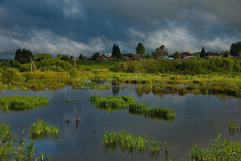 Picturesque cloud cover over the dacha village. Russia. Kemerovo region Kuzbass. Dacha village on the shore of a swampy lake near the city of Mariinsk royalty free stock images