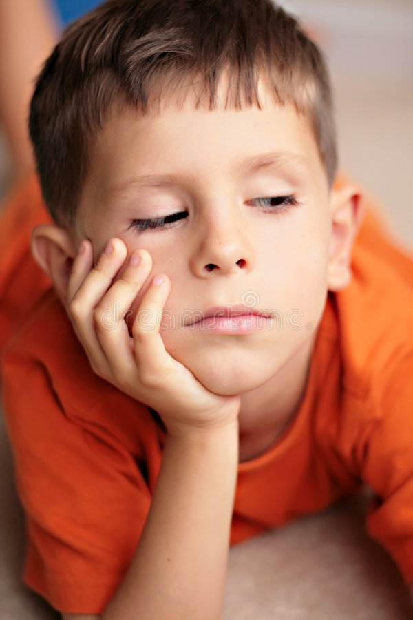 Sad, bored, daydreaming child. Sad, bored, thoughtful or daydreaming child stock photos