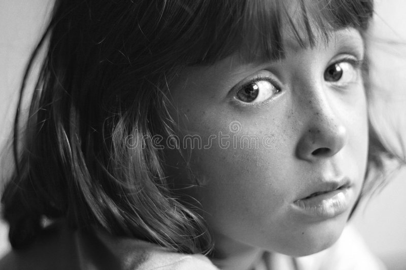 Sad, bored, daydreaming child. Sad, bored, thoughtful or daydreaming child stock images