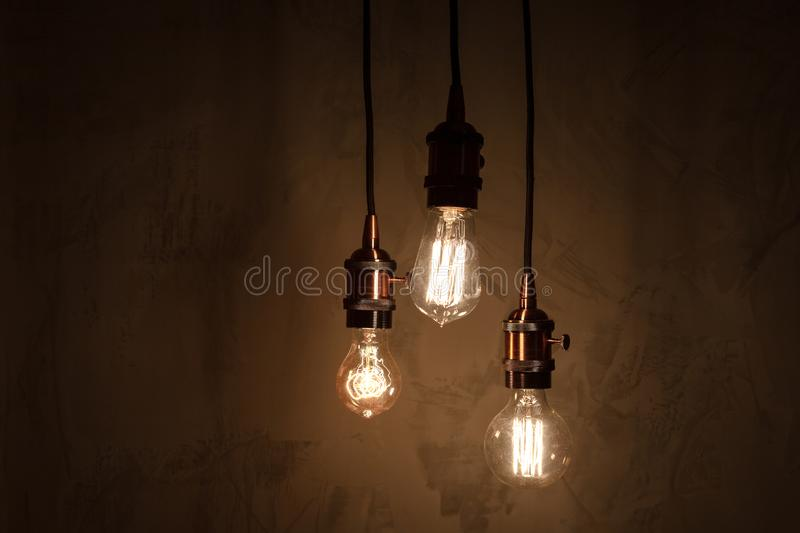 Set of three different lamps with vintage copper sockets.  royalty free stock photos