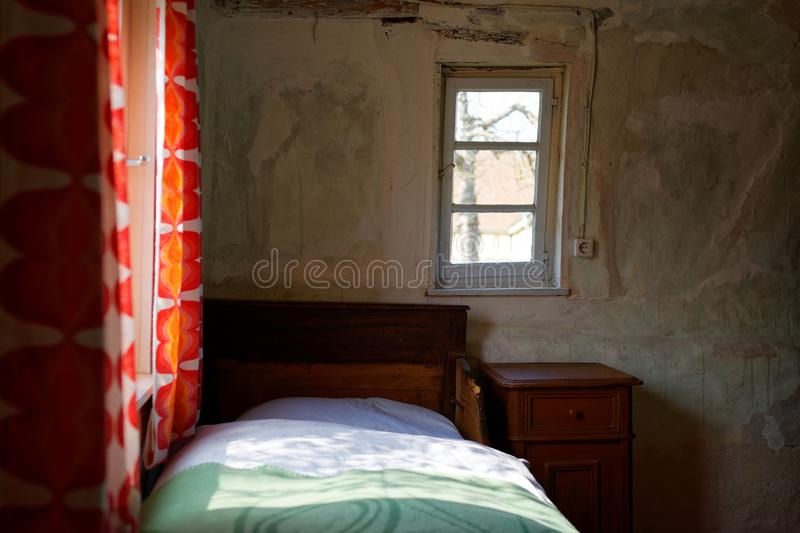 Simple bedroom of old peasant house stock photos