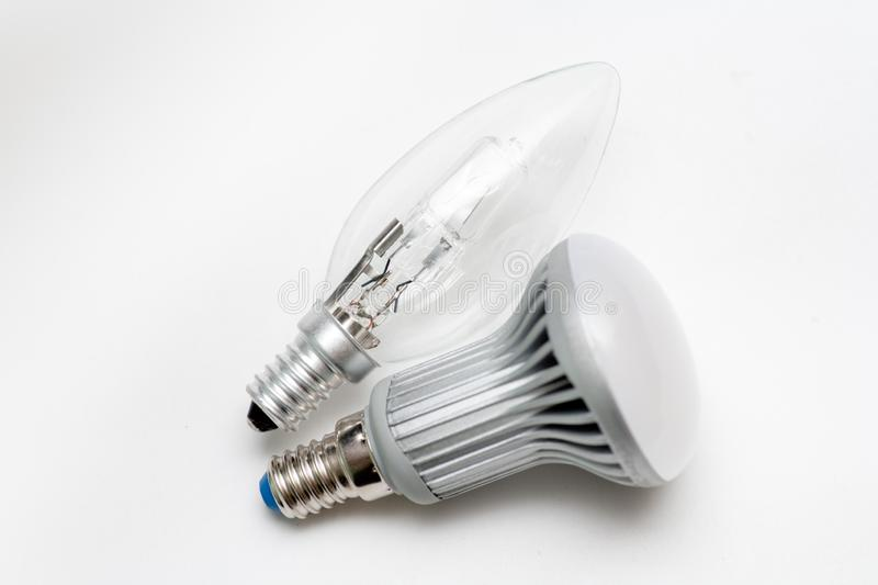 Tangsten and LED lamps with E27 socket. Image on white background. Climate change needs humanity to decrease energy consumption and led-lamps is one of the ways stock image