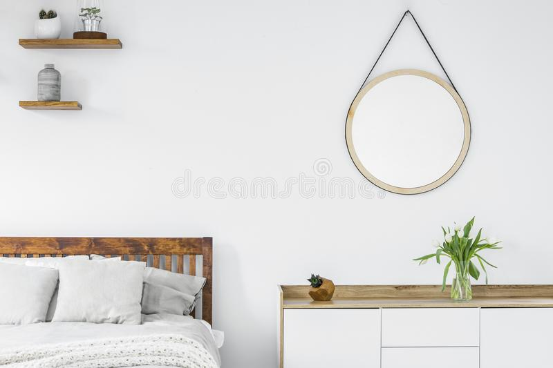 Tulips on a scandinavian style dresser, wooden shelves with plan stock images
