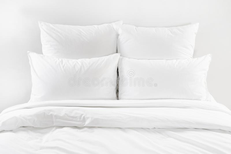 White bed , four white pillows and duvet on a bed royalty free stock images
