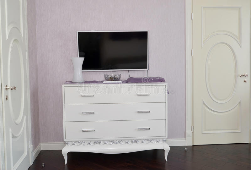 White dresser in a bedroom. royalty free stock images