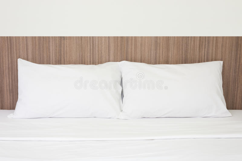 White pillows on a bed royalty free stock image
