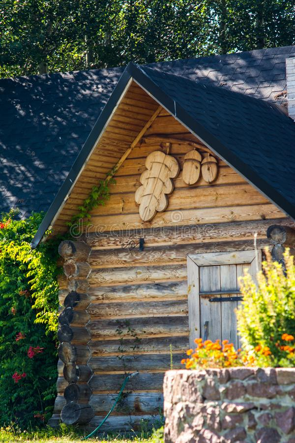 Wooden dacha house with garden. In summer stock image