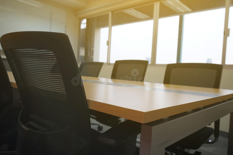Wooden table in meeting room white board sunlight from window stock photo